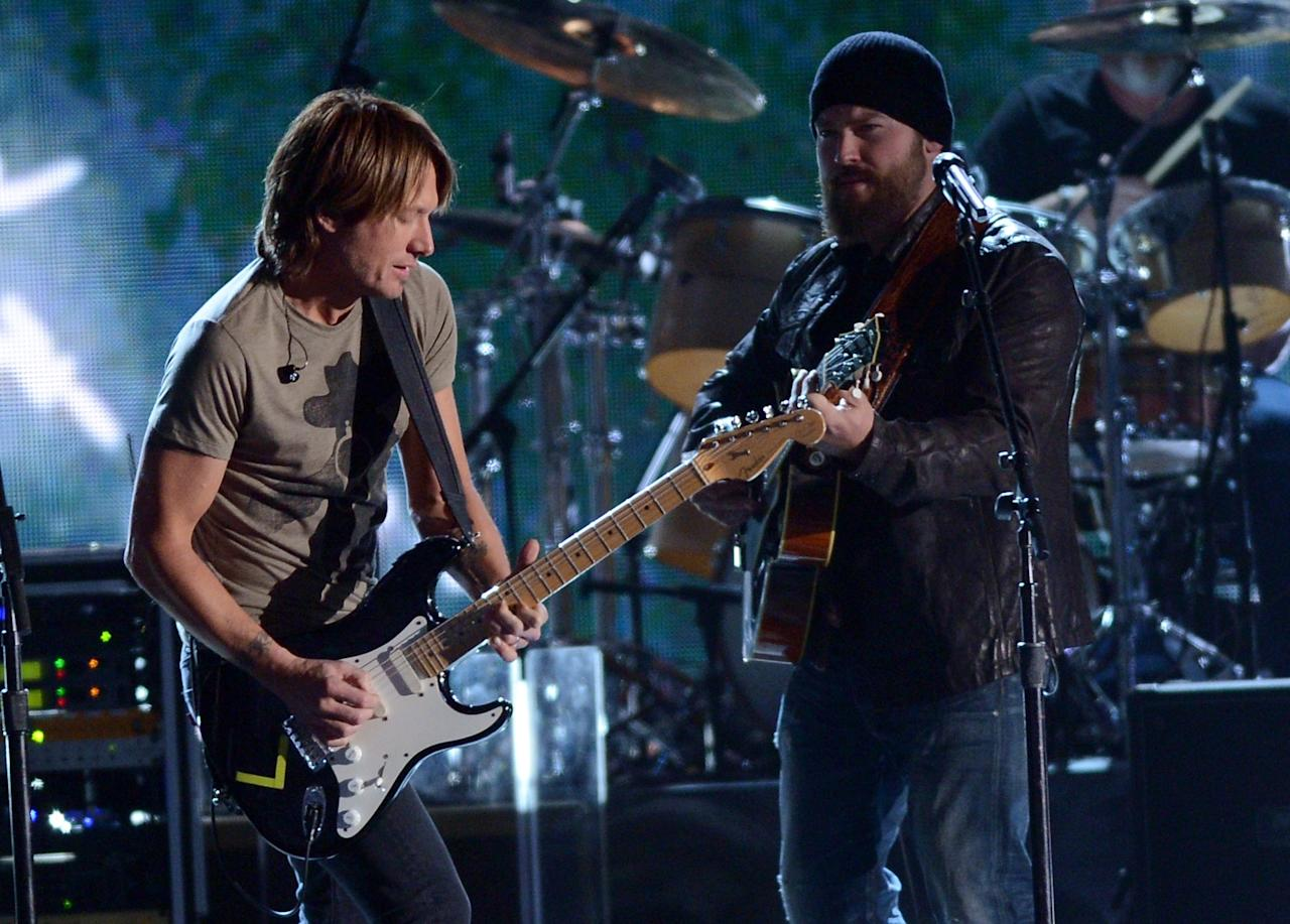 NASHVILLE, TN - NOVEMBER 01:  (L-R)  Keith Urban and Zac Brown perform during the 46th annual CMA Awards at the Bridgestone Arena on November 1, 2012 in Nashville, Tennessee.  (Photo by Jason Kempin/Getty Images)