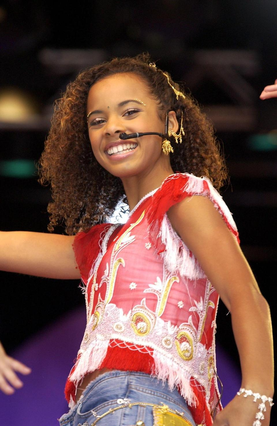 <p>Then: Another stand-out member of S Club Juniors was Rochelle, with her trademark curls and big smile. [Photo: Getty] </p>