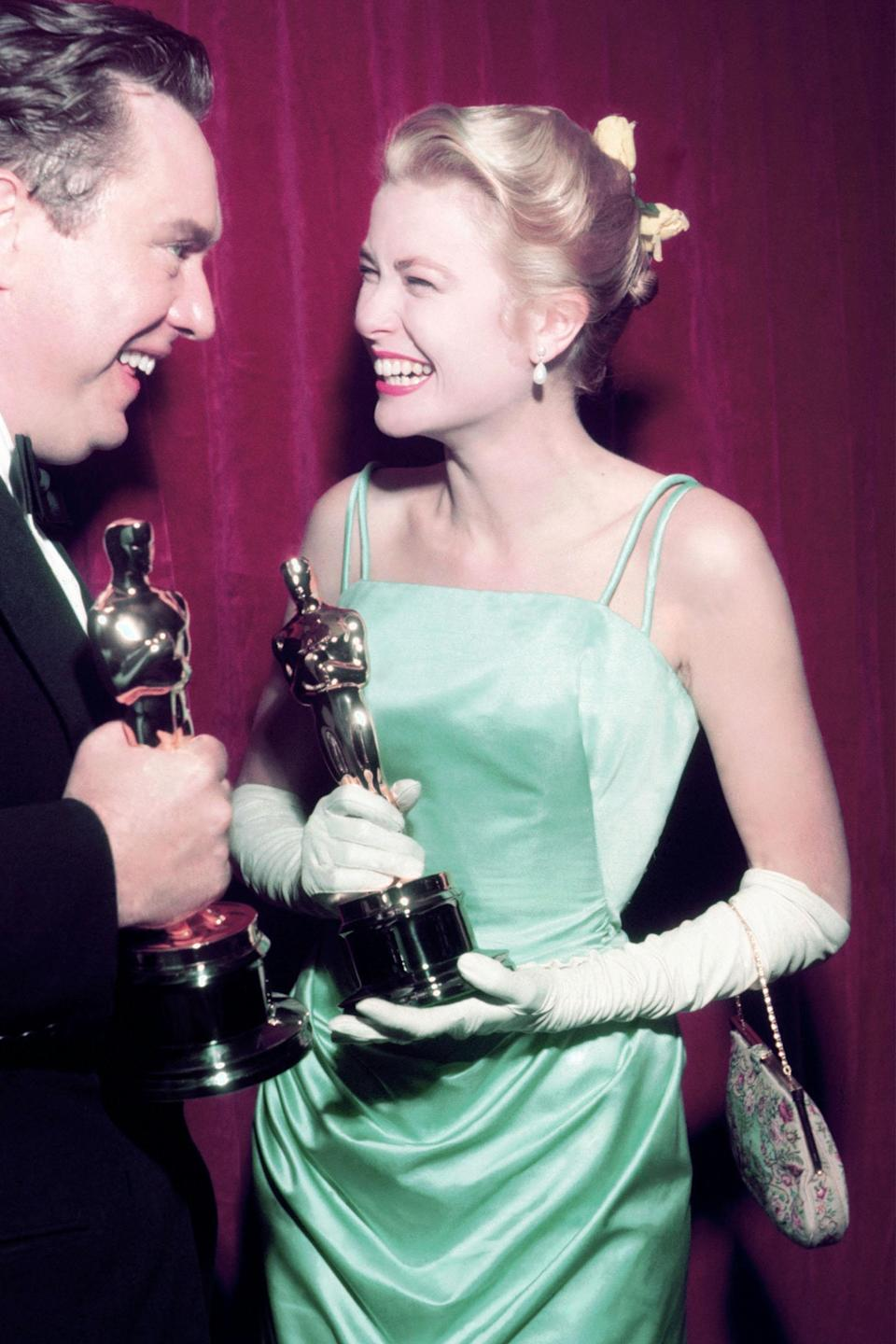 """<h2>Grace Kelly, 1955<br></h2><br>Designed by arguably the most famous costumier in history, Edith Head, Grace Kelly's Oscars look was, like most Grace Kelly looks, an absolute winner.<br><br><em>Grace Kelly in Edith Head. </em><span class=""""copyright"""">Photo: Silver Screen Collection/Hulton Archive/Getty Images. </span>"""