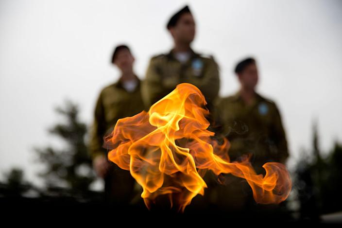 <p>Israeli soldiers stand by a flame at the Armored Corps memorial site during a ceremony marking the annual Memorial Day for soldiers and civilians killed in more than a century of conflict between Jews and Arabs, in Latrun, Israel, Monday, May 1, 2017. (AP Photo/Ariel Schalit) </p>