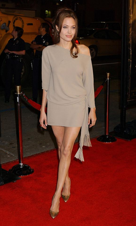 """14. <a href=""""http://movies.yahoo.com/movie/1808406164/info"""">Taking Lives</a> LA premiere (2004)   The big screen beauty -- who rarely wears anything but basic black -- showed off her gorgeous gams in a skimpy, sand-colored Celine dress and gold Michael Kors pumps at the psychological thriller's debut."""