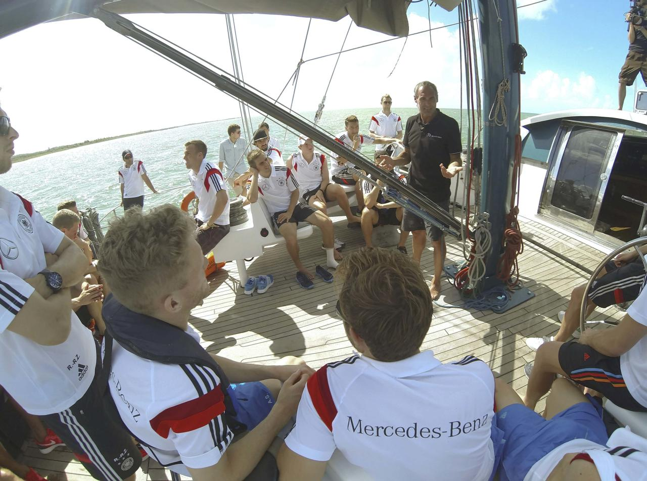 Germany's national soccer team memebers listen to explorer and adventurer Mike Horn of Switzerland (C) aboard the sailing ship 'Pangaea' near Santo Andre village, near Porto Seguro June 10, 2014. REUTERS/Markus Gilliar/Pool (BRAZIL - Tags: SPORT SOCCER WORLD CUP )