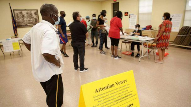 PHOTO: Voters wait in line to receive provisional ballots at a polling site in Hackensack, N.J., July 7, 2020. (Seth Wenig/AP)