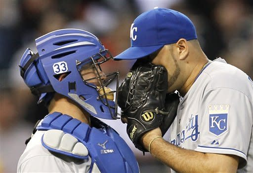 Kansas City Royals catcher Humberto Quintero, left, talks with starting pitcher Felipe Paulino, during the third inning of a baseball game against the Chicago White Sox Friday, May 11, 2012, in Chicago. (AP Photo/Charles Rex Arbogast)