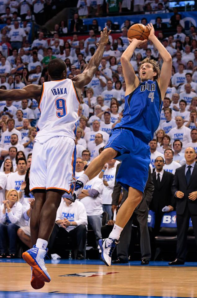 OKLAHOMA CITY, OK - APRIL 30: Dirk Nowitzki #41 of the Dallas Mavericks shoots under pressure from Serge Ibaka #9 of the Oklahoma City Thunder  in Game Two of the Western Conference Quarterfinals in the 2012 NBA Playoffs on April 30, 2012 at the Chesapeake Energy Arena in Oklahoma City, Oklahoma. Oklahoma City defeated Dallas 102-99. NOTE TO USER: User expressly acknowledges and agrees that, by downloading and or using the photograph, User is consenting to the terms and conditions of the Getty Images License Agreement. (Photo by Brett Deering/Getty Images)