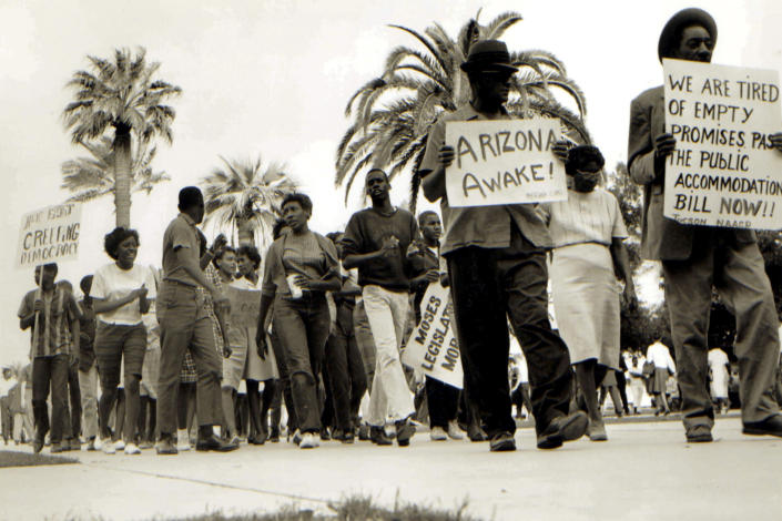 In this 1962 photo, Civil Rights leader Lincoln Ragsdale and supporters march on the Arizona state capitol in Phoenix, for the desegregation of public places with the public accommodation bill prior to the Civil Rights Act of 1964. Phoenix's past segregation has been in focus after last month's national outrage over a videotaped encounter of police pointing guns and cursing at a black family. (Lincoln Ragsdale Jr/Matthew Whitaker Photographs, University Archives, Arizona State University Library via AP)