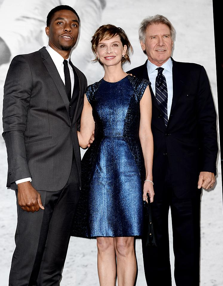 "LOS ANGELES, CA - APRIL 09:  (L-R) Actors Chadwick Boseman, Calista Flockhart and Harrison Ford arrive at the premiere of Warner Bros. Pictures' and Legendary Pictures' ""42"" at the Chinese Theatre on April 9, 2013 in Los Angeles, California.  (Photo by Kevin Winter/Getty Images)"