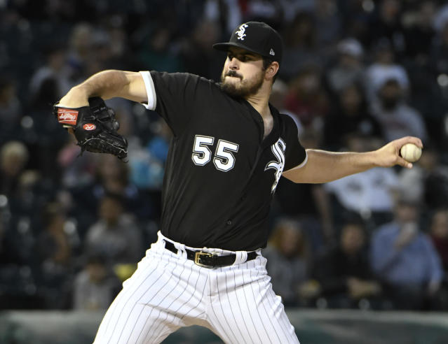 Chicago White Sox starting pitcher Carlos Rodon (55) throws the ball against the Los Angeles Angels during the first inning of a baseball game, Friday, Sept. 7, 2018, in Chicago. (AP Photo/David Banks)