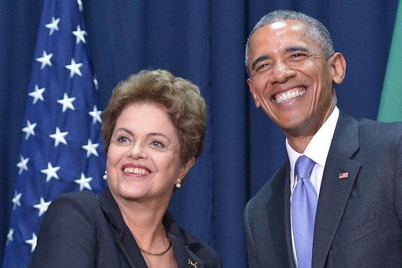 US President Barack Obama (R) poses with Brazilian President Dilma Rousseff during a meeting on the sidelines of the Summit of the Americas on April 11, 2015 in Panama City