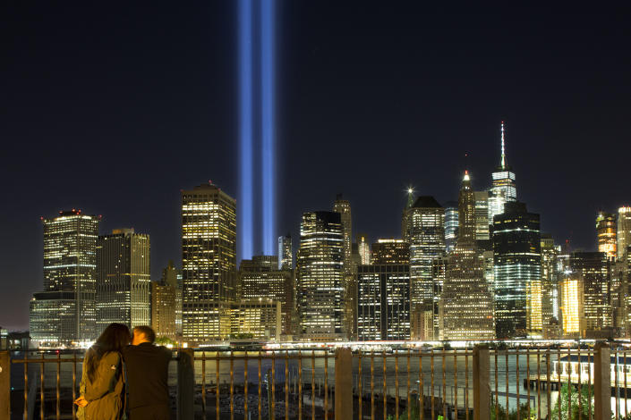 <p> A couple embraces on the Brooklyn Promenade as the Tribute in Light rises above the lower Manhattan skyline Sunday, Sept. 10, 2017, in New York. The two blue pillars of light provide a visual reminder of how the Twin Towers, destroyed in the terrorist attacks of Sept. 11, 2001, once stood above the city skyline. (AP Photo/Mark Lennihan) </p>