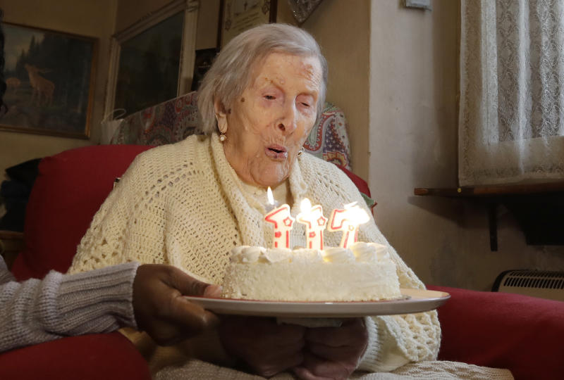 FILE - In this Tuesday, Nov. 29, 2016 file photo, Emma Morano, 117 years old, blows candles on the day of her birthday in Verbania, Italy. An Italian doctor says Saturday, April 15, 2017 Emma Morano, at 117 the world's oldest person, has died in her home in northern Italy. Dr. Carlo Bava told The Associated Press by telephone that Morano's caretaker called him to say the woman had passed away Saturday afternoon while sitting in an armchair in her home in Verbania, a town on Lake Maggiore. (AP Photo/Antonio Calanni, File)
