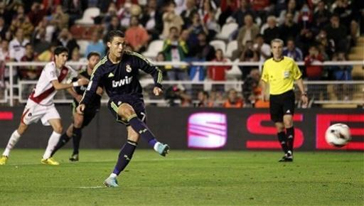 Real Madrid's Cristiano Ronaldo from Portugal, centre, scores his goal during a Spanish La Liga soccer match against Rayo Vallecano at the Vallecas stadium in Madrid, Spain, Monday, Sept. 24, 2012. (AP Photo/Andres Kudacki)
