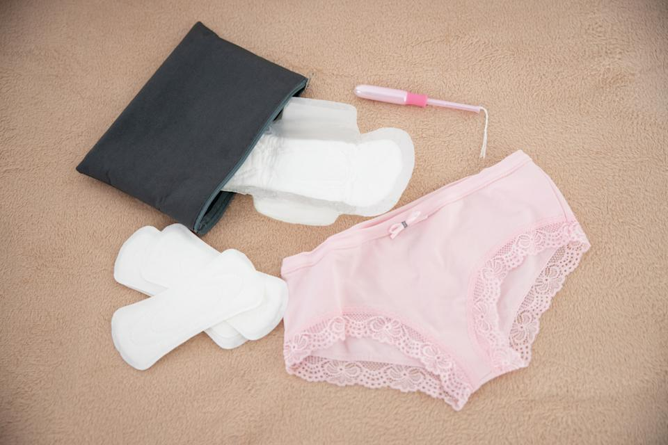 Close up of panties, daily pads, cosmetic bag with sanitary napkin and tampon stock photo