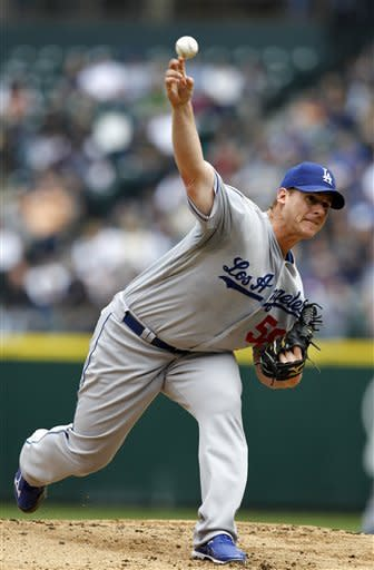 Los Angeles Dodgers starting pitcher Chad Billingsley throws against the Seattle Mariners in the first inning of a baseball game on Sunday, June 10, 2012, in Seattle. (AP Photo/Elaine Thompson)
