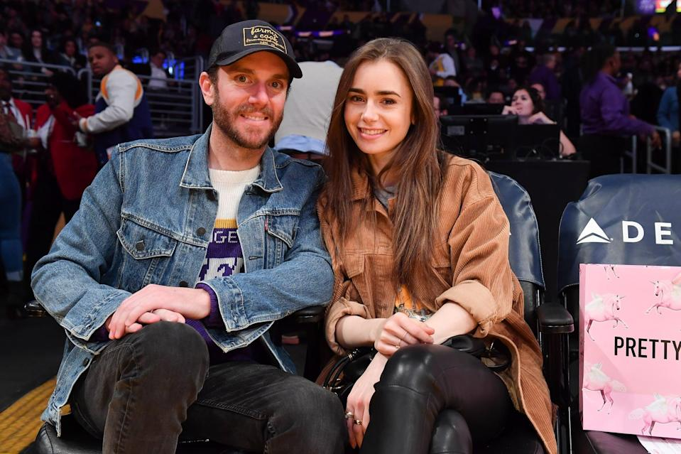 """<p>Lily and Charlie McDowell started dating in 2019, but we didn't know for sure until Lily posted <a href=""""https://www.instagram.com/p/B1Y_uW-pMst/?utm_source=ig_embed"""" class=""""link rapid-noclick-resp"""" rel=""""nofollow noopener"""" target=""""_blank"""" data-ylk=""""slk:an adorable Instagram pic with him"""">an adorable Instagram pic with him</a> last August. Since then, <a href=""""https://www.popsugar.com/celebrity/lily-collins-charlie-mcdowell-cutest-pictures-47818327"""" class=""""link rapid-noclick-resp"""" rel=""""nofollow noopener"""" target=""""_blank"""" data-ylk=""""slk:the pair have been spotted out and about hiking"""">the pair have been spotted out and about hiking</a>, attending basketball games together, and generally living the happy couple life. After more than a year together, <a href=""""https://www.popsugar.com/celebrity/lily-collins-charlie-mcdowell-are-engaged-47826329"""" class=""""link rapid-noclick-resp"""" rel=""""nofollow noopener"""" target=""""_blank"""" data-ylk=""""slk:Lily and Charlie got engaged"""">Lily and Charlie got engaged</a>, and we couldn't be happier for them!</p>"""