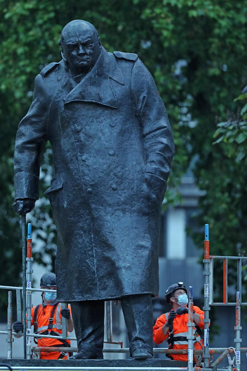 The statue of Churchill was covered up after being daubed with graffiti during Black Lives Matters protests. (PA)