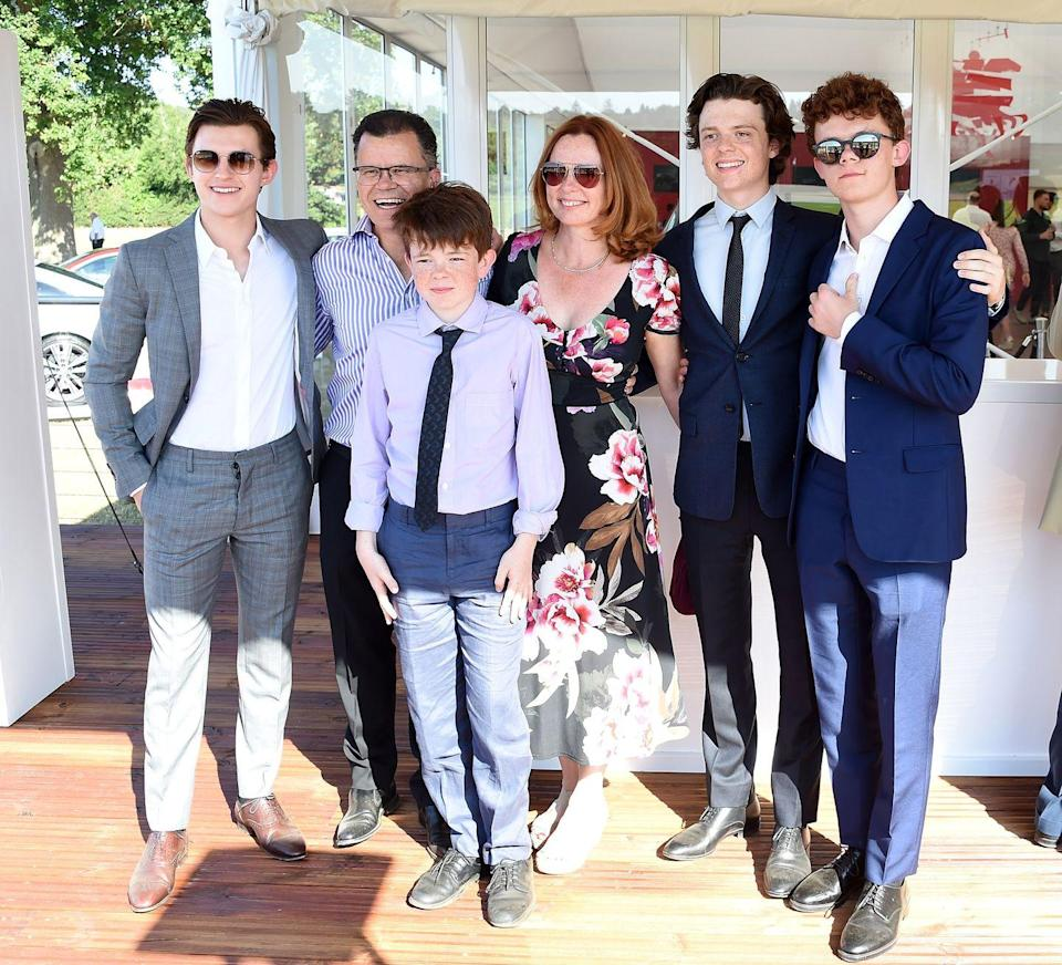 <p>Tom Holland poses with his family Dominic Holland, Paddy Holland, Nicola Holland, Sam Holland and Harry Holland at the Audi Polo Challenge at Coworth Park Polo Club on June 30, 2018 in Ascot, England.</p>