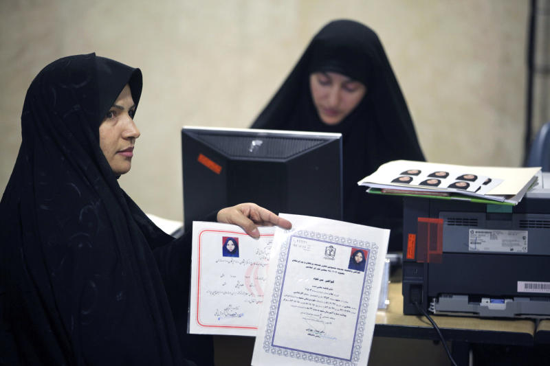 Fatemeh Mohebbi Nasab, shows her certifications to media, while registering her candidacy for the upcoming presidential election, at the election headquarters of the interior ministry in Tehran, Iran, Thursday, May 9, 2013. Authorities on Tuesday officially opened the registration process for candidates in next month's election that will pick a successor to President Mahmoud Ahmadinejad. The five-day registration period for candidates closes Saturday. The election overseers, known as the Guardian Council, will announce the handful of candidates on the ballot later this month. (AP Photo/Vahid Salemi)