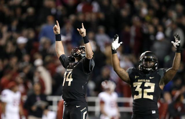 Baylor quarterback Bryce Petty (14) and running back Shock Linwood (32) celebrate a touchdown catch by Antwan Goodley in the second half of an NCAA college football game against Oklahoma, Thursday, Nov. 7, 2013, in Waco, Texas. Baylor won 41-12. (AP Photo/Tony Gutierrez)