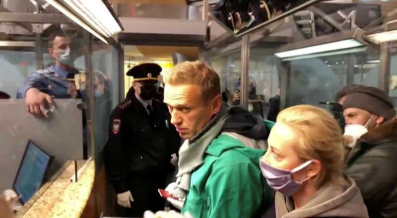 Police officers detain Russian opposition leader Alexei Navalny in Moscow