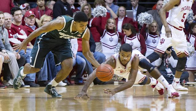 Michigan State's Gary Harris (14) steals the ball away from Indiana's Jeremy Hollowell (33) in the first half of an NCAA college basketball game, Saturday, Jan. 4, 2014, in Bloomington, Ind. (AP Photo/Doug McSchooler)