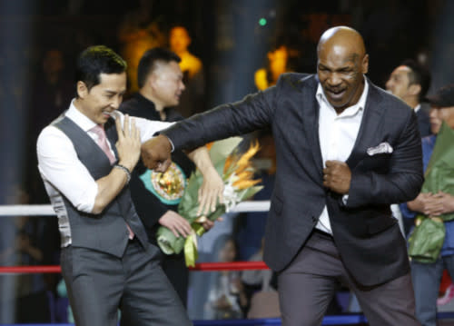 Donnie and Mike Tyson faking some punches during the press conference of 'Ip Man 3' back in 2015