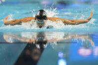 Torri Huske participates in the Women's 100 Butterfly during wave 2 of the U.S. Olympic Swim Trials on Monday, June 14, 2021, in Omaha, Neb. (AP Photo/Charlie Neibergall)
