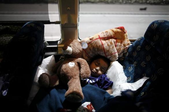 A boy sleeps on the bus after visiting a relative at San Quentin state prison in San Quentin, California June 8, 2012.