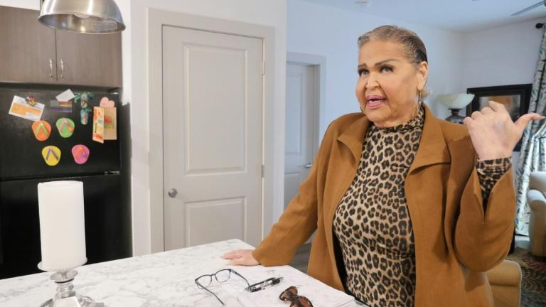 Dina Jacobs speaks in the kitchen of her new apartment during the opening of the Law Harrington Senior Living Center, the largest LGBTQ senior residence in the United States, in Houston, Texas