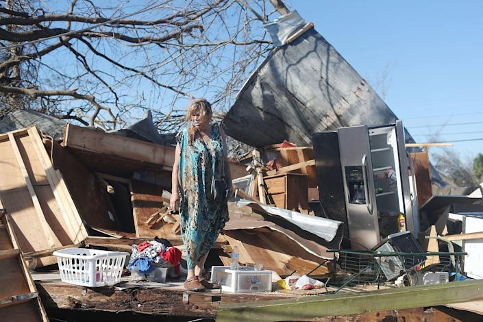 Kathy Coy stands among what is left of her home in Panama City after Hurricane Michael destroyed it. She said she was in the home when it was blown apart and is thankful to be alive.