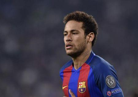 Barcelona's Neymar looks on