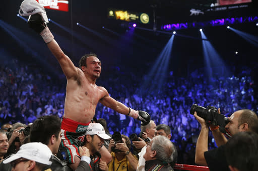 FILE - In this Dec. 8, 2012, file photo, Juan Manuel Marquez, of Mexico, celebrates his win over Manny Pacquiao in a WBO world welterweight fight, in Las Vegas. Marquez was elected to the International Boxing Hall of Fame, Wednesday, Dec. 4, 2019. (AP Photo/Eric Jamison, File)