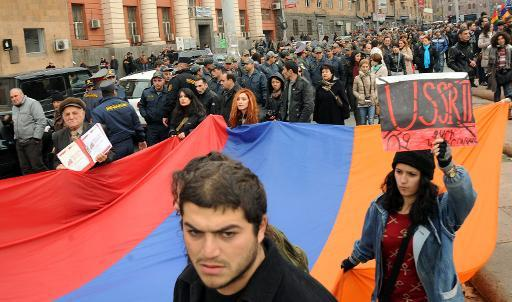 <p>Armenian anti-Putin demonstrators rally in Yerevan, on December 2, 2013, to protest against the visit of Russia's president</p>