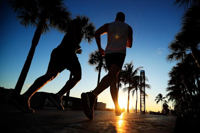 While government and health officials are asking people to refrain from large gatherings where COVID-19 could spread, even the strictest coronavirus regulations in America allow for going outside and exercising if you are healthy. (Photo by Cliff Hawkins/Getty Images)