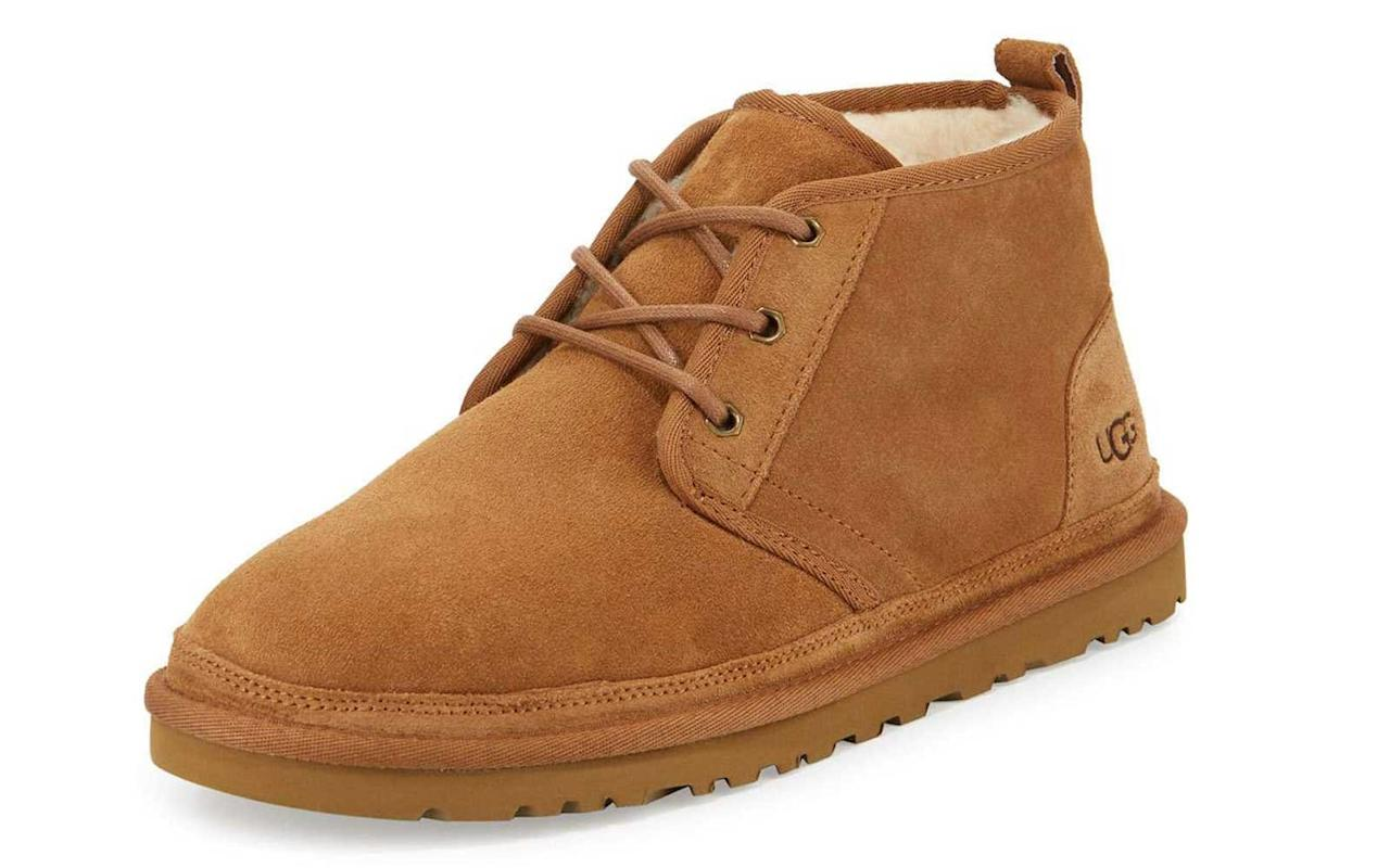 """<p>You may know Ugg for its ultra popular women's winter boots, but the brand also provides a variety of men's shoes. The suede desert boot is the perfect shoe for those chilly fall and winter days. The wool lining and footbed will keep your feet warm and comfortable throughout your travels.</p> <p>To buy: <a href=""""http://www.anrdoezrs.net/links/7876402/type/dlg/sid/TL%2CGiftsforMenWhoLovetoTravel%2Cwarrenj%2CGIF%2CGAL%2C455939%2C201911%2CI/https://www.zappos.com/p/ugg-neumel-chestnut-twinface/product/7843238/color/309555?PID=7876402"""" target=""""_blank"""">zappos.com</a>, $130</p>"""