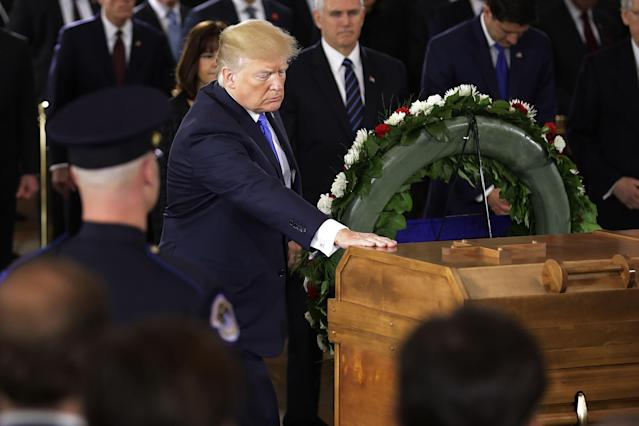 <p>President Donald Trump touches the casket containing the late Rev. Billy Graham as it lies in honor in the U.S. Capitol Rotunda in Washington, Feb. 28, 2018. (Photo: Chip Somodevilla/Pool/Reuters) </p>