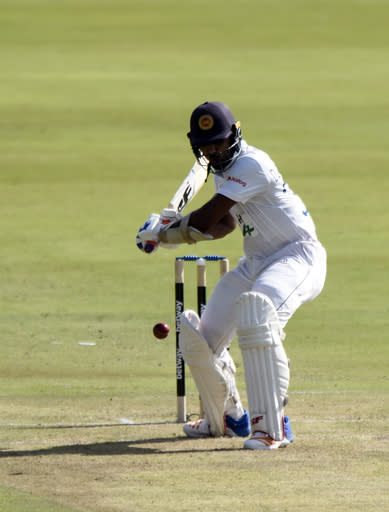 Sri Lanka's Dinesh Chandimal plays a shot back past the bowler on day one of the first cricket test match between South Africa and Sri Lanka at Super Sport Park Stadium in Pretoria, South Africa, Saturday, Dec. 26, 2020.(AP Photo/Catherine Kotze)