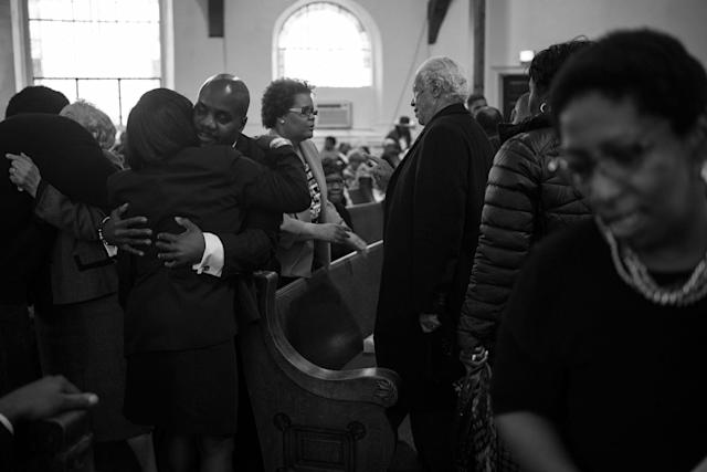 <p>Spencer Leak Sr greets a family member of the deceased at a funeral at the Union Tabernacle Missionary Baptist Church on Chicago's south side. (Photo: Jon Lowenstein/NOOR for Yahoo News) </p>