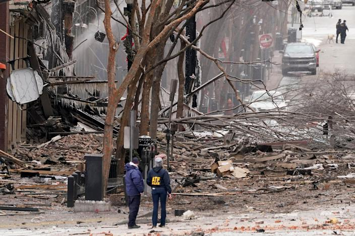 Emergency personnel work near the scene of an explosion in downtown Nashville, Tenn., Friday, Dec. 25, 2020. Buildings shook in the immediate area and beyond after a loud boom was heard early Christmas morning.(AP Photo/Mark Humphrey) (AP)