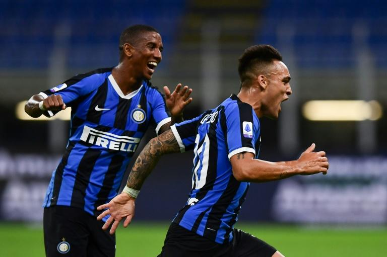 Lautaro Martinez (R) and Ashley Young helped fire Inter second in Serie A with goals agianst Torino on Monday