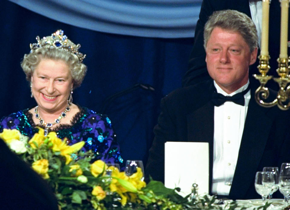 FILE - In this Saturday, June 4, 1994 file photo, Britain's Queen Elizabeth smiles, as she sits alongside President Bill Clinton at a dinner in the Guildhall in Portsmouth, England, commemorating the 50th anniversary of D-Day. (AP Photo/Doug Mills, File)