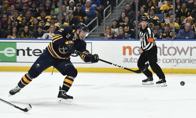 Buffalo Sabres center Johan Larsson (22) scores a short-handed goal past Boston Bruins goalie Tuukka Rask (40) during the second period of an NHL hockey game in Buffalo, N.Y., Saturday, Dec. 29, 2018. (AP Photo/Adrian Kraus)