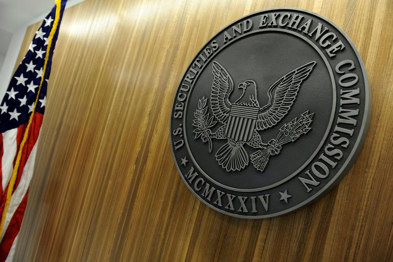 FILE PHOTO: The seal of the U.S. Securities and Exchange Commission hangs on the wall at SEC headquarters in Washington