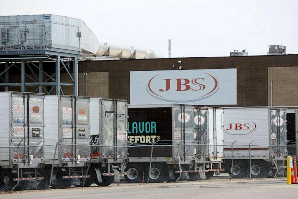 PHOTO: Trucks are parked outside the JBS meat plant in Plainwell, Michigan, June 2, 2021. (Jeff Kowalsky/AFP via Getty Images)