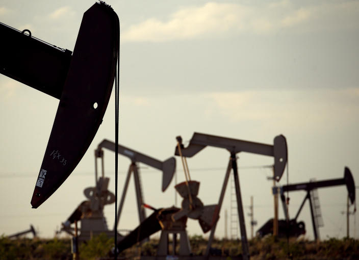 FILE - In this April 24, 2015, file photo, pumpjacks work in a field near Lovington, N.M. In the closing months of the Trump administration, energy companies stockpiled enough drilling permits for western public lands to keep pumping oil for years. That stands to undercut President-elect Joe Biden's plans to block new drilling on public lands to address climate change. (AP Photo/Charlie Riedel, File)