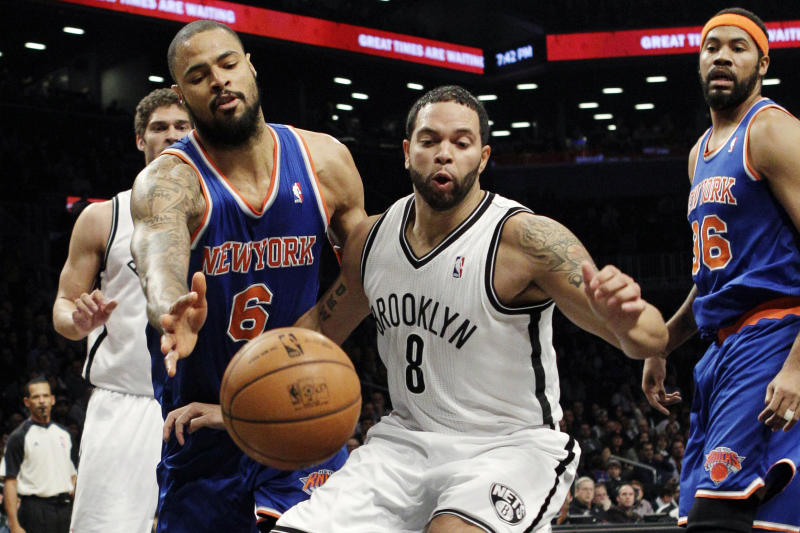 New York Knicks center Tyson Chandler (6) knocks the ball from the hands of Brooklyn Nets guard Deron Williams (8) in the first half of their NBA basketball game at Barclays Center, Monday, Nov. 26, 2012, in New York. Nets' Brook Lopez, rear left, and Knicks' Rasheed Wallace (36) watch the play. (AP Photo/Kathy Willens)