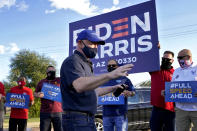 Mark Kelly, Democratic candidate for the U.S. Senate, greets supporters at a polling station, Tuesday, Nov. 3, 2020, in Phoenix. Kelly is seeking to unseat incumbent Martha McSally. (AP Photo/Matt York)