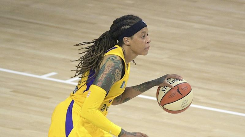Los Angeles Sparks guard Seimone Augustus (33) brings the ball up the court during the first half of a WNBA basketball game against the Phoenix Mercury, Saturday, July 25, 2020, in Bradenton, Fla. (AP Photo/Phelan M. Ebenhack)