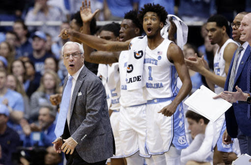 North Carolina head coach Roy Williams reacts with players during the first half of an NCAA college basketball game against Louisville in Chapel Hill, N.C., Saturday, Jan. 12, 2019. (AP Photo/Gerry Broome)