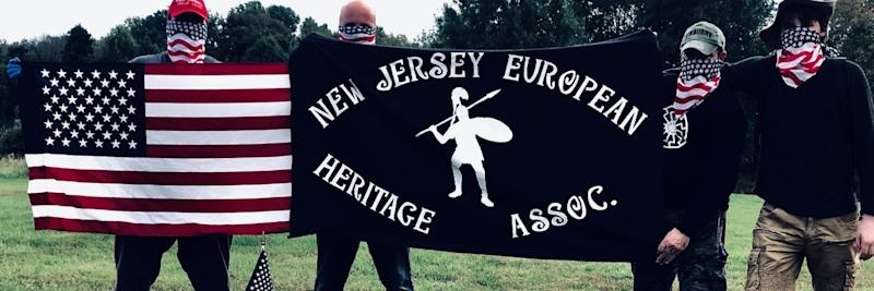 Four members of the New Jersey European Heritage Association pose with American flag bandanas to cover their face. (Credit: Twitter/NJEHA)